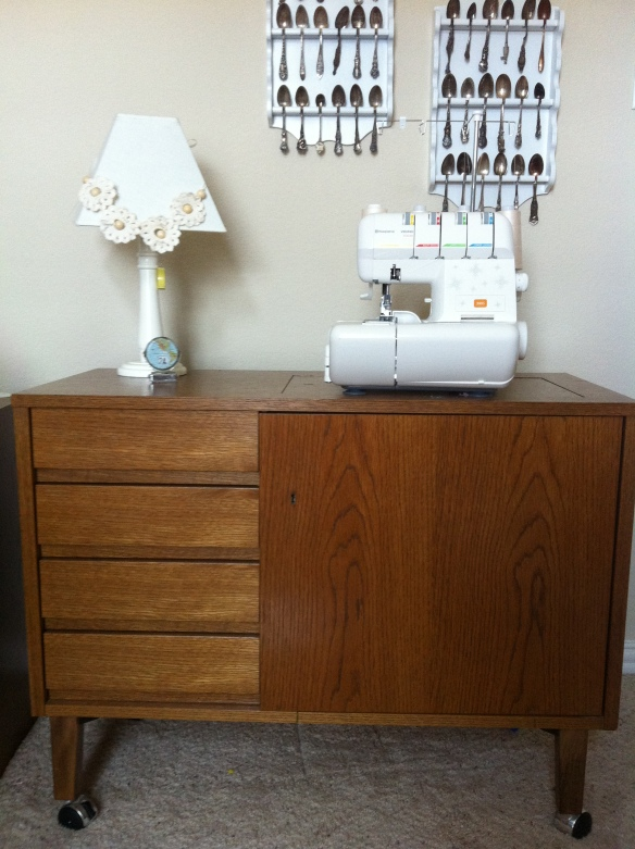 I got there first and am now the proud owner of this sewing table.  The down side to this purchase was the three flights of narrow spiral stairs my husband and I had to carry it down.